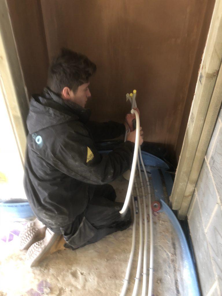 preparing-underfloor-heating-pipes